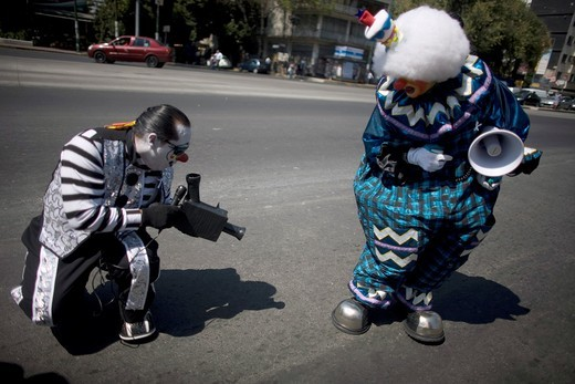 A clown pretends he is recording as he use a fake camera made of cardboard during the 16th International Clown Convention: The Laughter Fair organized by the Latino Clown Brotherhood, in Mexico City, October 17, 2011 : Stock Photo