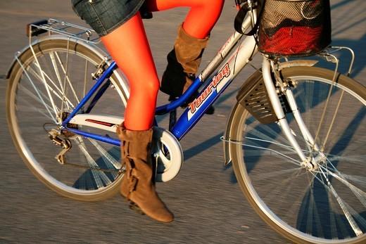 Stock Photo: 1566-950248 woman riding bike in town