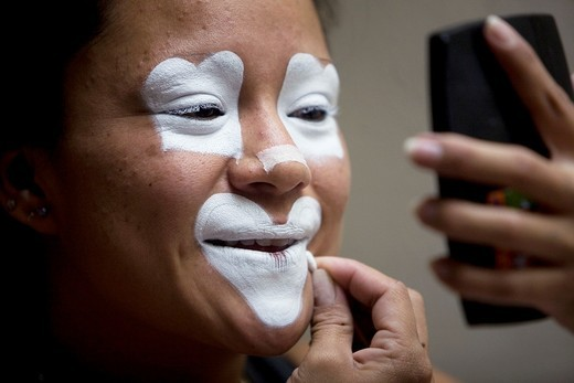 Stock Photo: 1566-950322 A female clown makes up in her hotel room during the 16th International Clown Convention: The Laughter Fair organized by the Latino Clown Brotherhood, in Mexico City, October 17, 2011