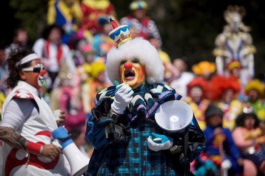 A clown uses a megaphone during the 16th International Clown Convention: The Laughter Fair organized by the Latino Clown Brotherhood, in Mexico City, October 17, 2011 : Stock Photo
