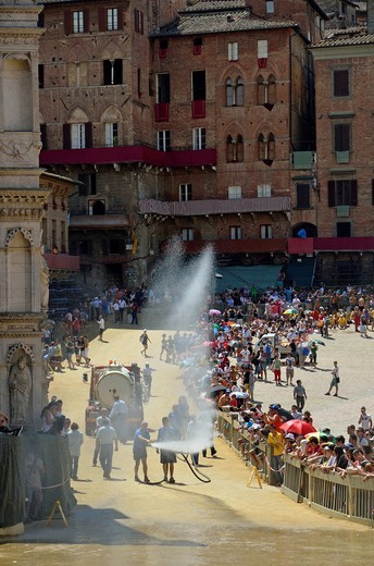 City employees water spraying the Piazza del Campo before the horse race on Palio di Siena day, Siena, Tuscany, Italy : Stock Photo
