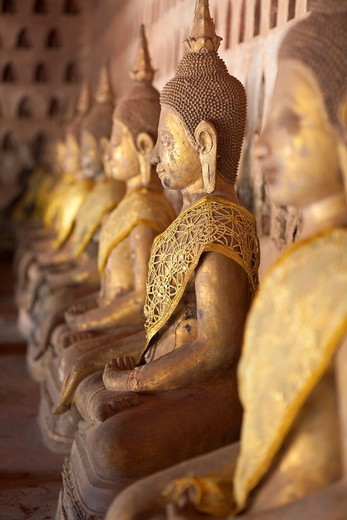 Stock Photo: 1566-956797 Ancient Buddha images line the courtyard walkway at Wat Si Saket in Vientiane, Laos