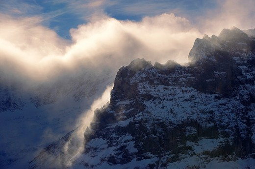 Sun and clouds on the Schreckhorn mountain - Swiss Alps : Stock Photo