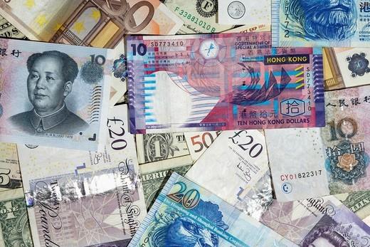 Stock Photo: 1566-957746 mulitple currencies including chinese renminbi rmb hong kong dollars us dollars british pounds and euro banknotes