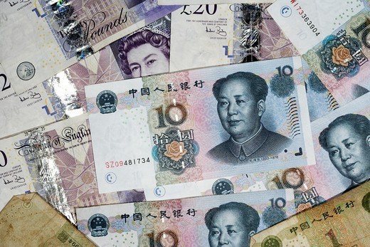 chinese renminbi rmb on top of british pounds banknotes : Stock Photo