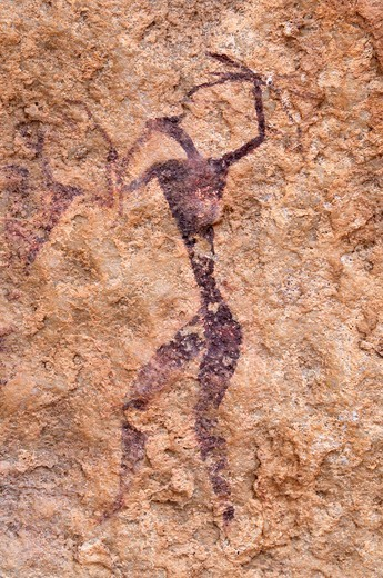 painted warrior, neolithic rockart at Tin Meskis, Adrar n´ Ahnet, Algeria, Sahara, North Africa : Stock Photo