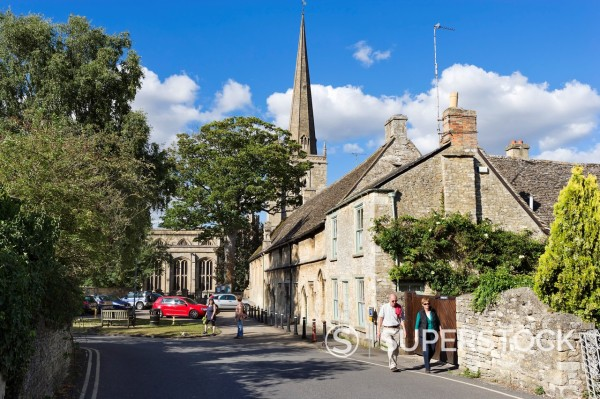 Stock Photo: 1566-960640 View towards St John the Baptist parish church on Church Lane in the Cotswold town of Burford, Oxfordshire, England, UK