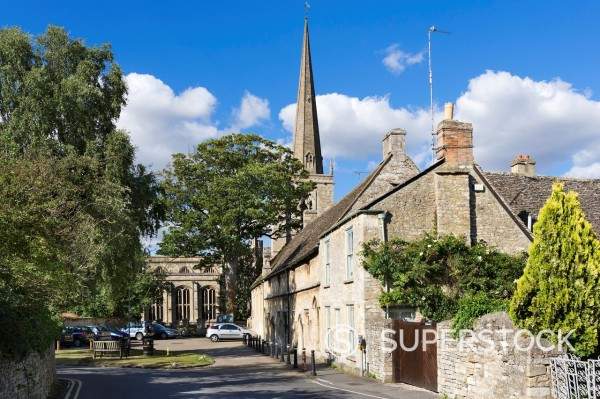 Stock Photo: 1566-960641 View towards St John the Baptist parish church on Church Lane in the Cotswold town of Burford, Oxfordshire, England, UK