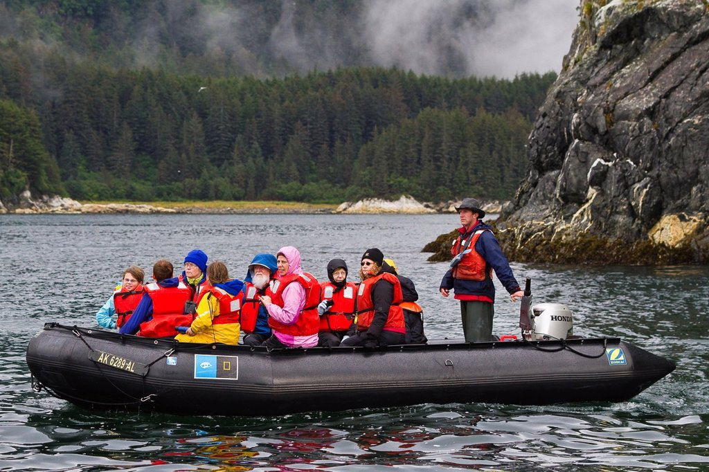 Guests from the Lindblad Expeditions ship National Geographic Sea Bird during Zodiac operations in Southeast Alaska, USA : Stock Photo