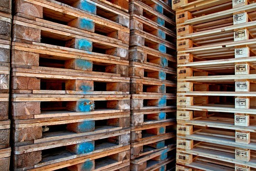 wooden pallets piled : Stock Photo