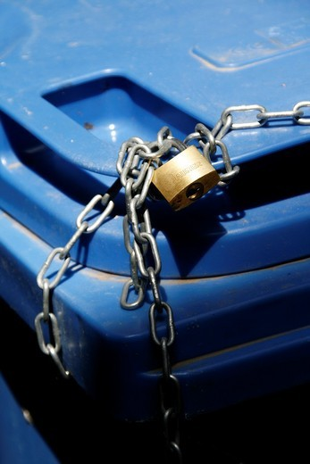 Stock Photo: 1566-966755 household rubbish bin locked with chain and padlock