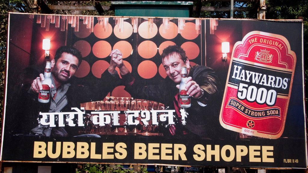 Bubbles Beer Shop sign advertising Haywards soda Sawantvadi, Maharashtra, India : Stock Photo