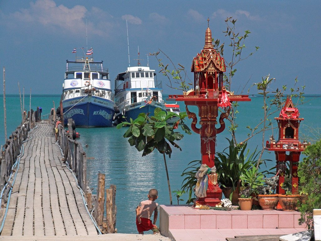 Spirit houses at Big Buddha Pier Samui island ferry gateway to nearby island Ko Pha Ngan Thailand : Stock Photo