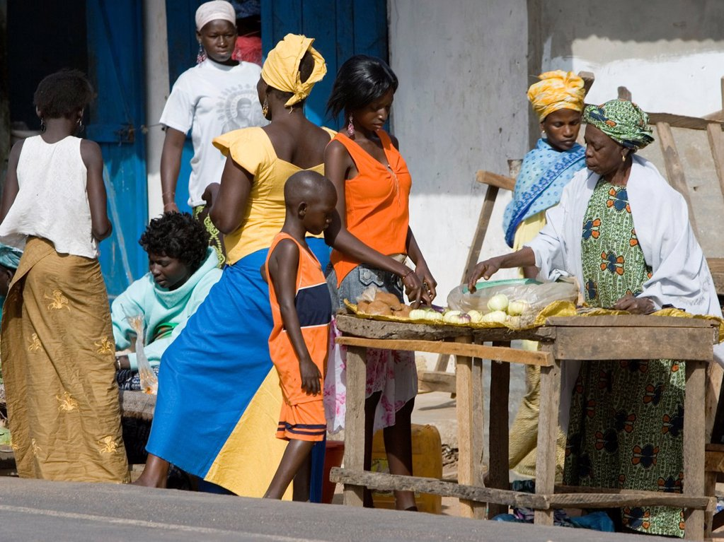 Stock Photo: 1566-969262 Women in traditional colorful clothes Sanyang open air street market The Gambia
