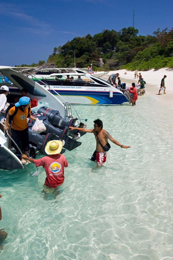 Stock Photo: 1566-969271 Visitors wade ashore from speed boats Similan Island Ko 8 Similan Islands Thailand
