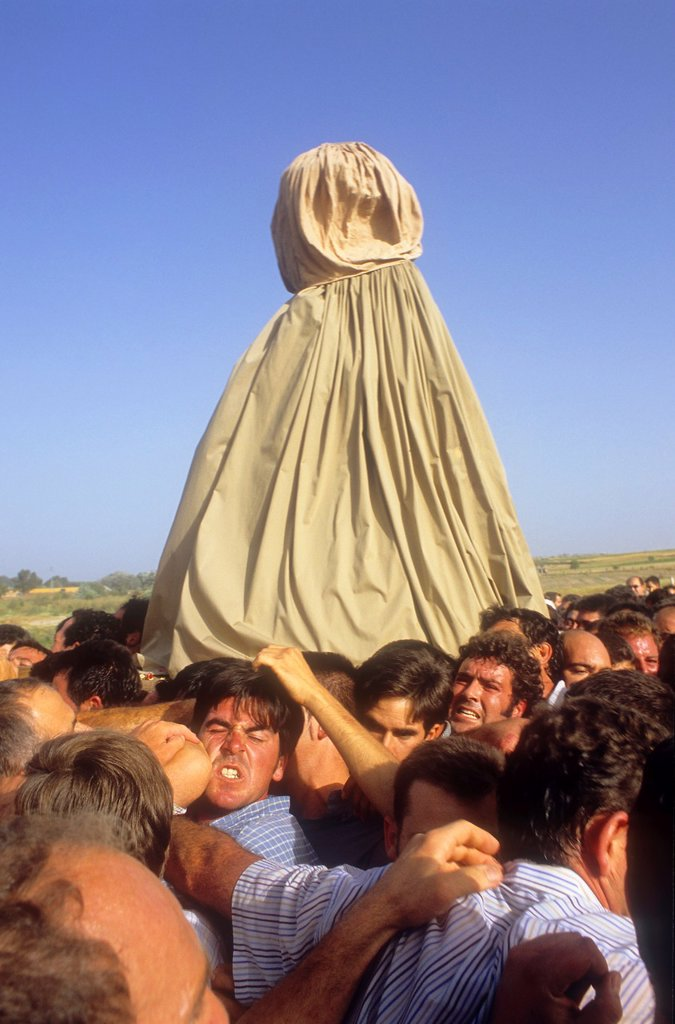 Stock Photo: 1566-969813 El Rocío Romería pilgrimage,Special procession,once every seven years the virgin of el Rocío travels from El Rocío to Almonte where he spends a few months, to finally go back to El Rocío,procession trip from Almonte to El Rocío,Almonte, Huelva province, S. El Rocío Romería pilgrimage,Special procession,once every seven years the virgin of el Rocío travels from El Rocío to Almonte where he spends a few months, to finally go back to El Rocío,procession trip from Almonte to El Rocío,Almonte, Huelva