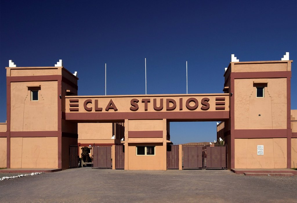 Stock Photo: 1566-969962 CLA film studios main gate near Ouarzazate Morocco