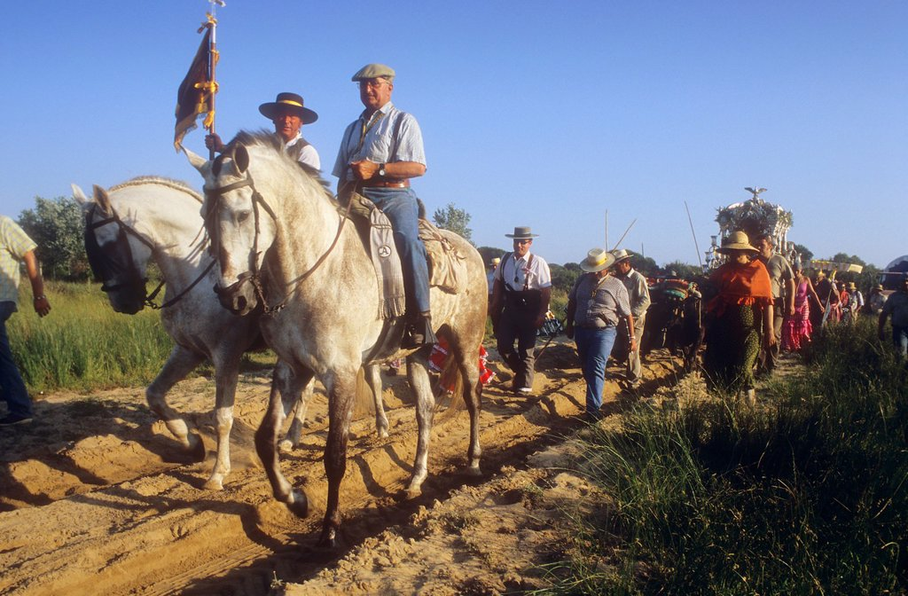 Pilgrims near Doñana Palace,Romeria del Rocio, pilgrims on their way through the Doñana National Park, pilgrimage of Sanlúcar de Barrameda brotherhood, to El Rocío, Almonte, Huelva province, Andalucia : Stock Photo