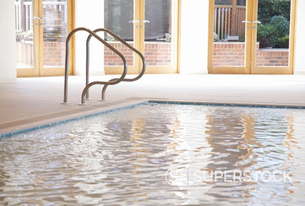 Swimming pool with handrail : Stock Photo