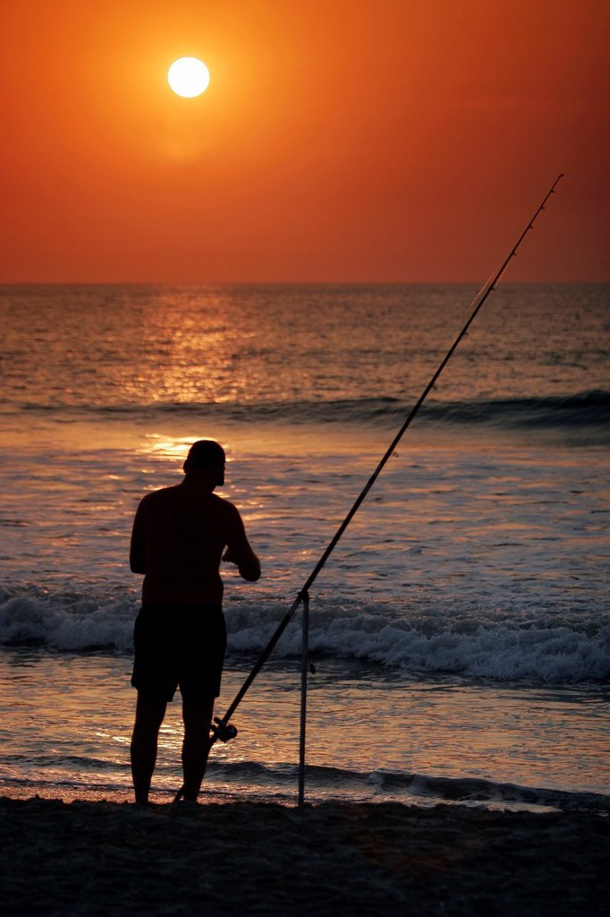 Stock Photo: 1566-971642 Fisherman at sunset by Boboi Beach Lodge near Kartong The Gambia