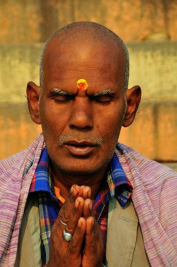 Man praying by the Holy Ganges River : Stock Photo