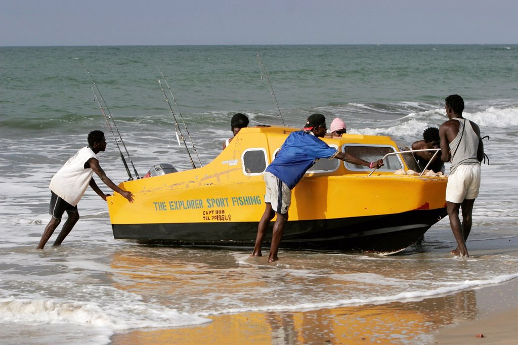 Stock Photo: 1566-972413 Sport fishing boat brought ashore beach Kololi The Gambia
