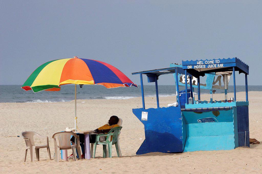 Stock Photo: 1566-972416 Colored umbrella and table at juice bar Palma Rima beach Kololi The Gambia
