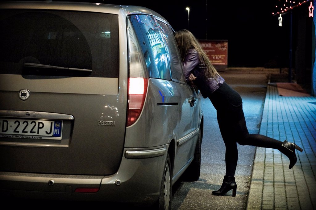 Approach with a client, Prostitution, Milan province, Italy : Stock Photo