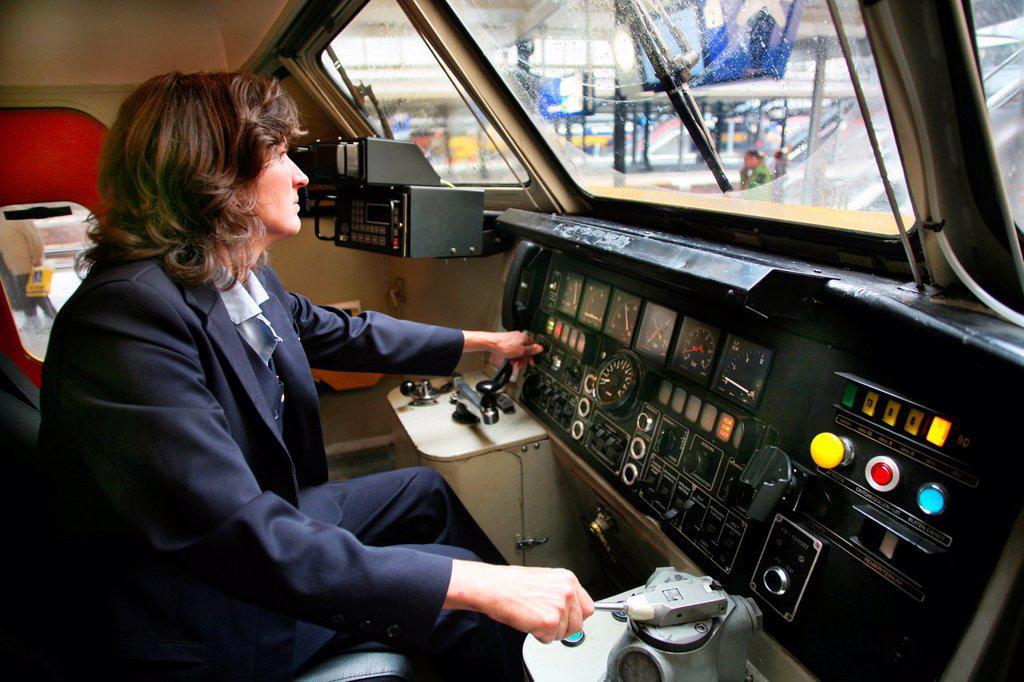 Female train driver at the the dutch railways : Stock Photo