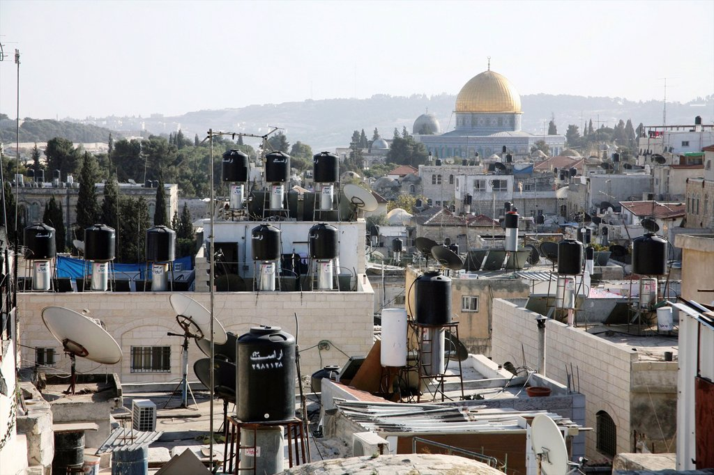 Stock Photo: 1566-976365 Rooftops full of chimneys and communications equipment in the old city section of Jerusalem Nearby the dome of the rock