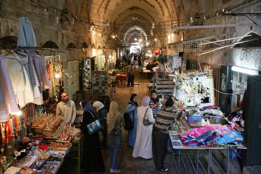 Stock Photo: 1566-976366 Muslim women at a market in the old city section of Jerusalem