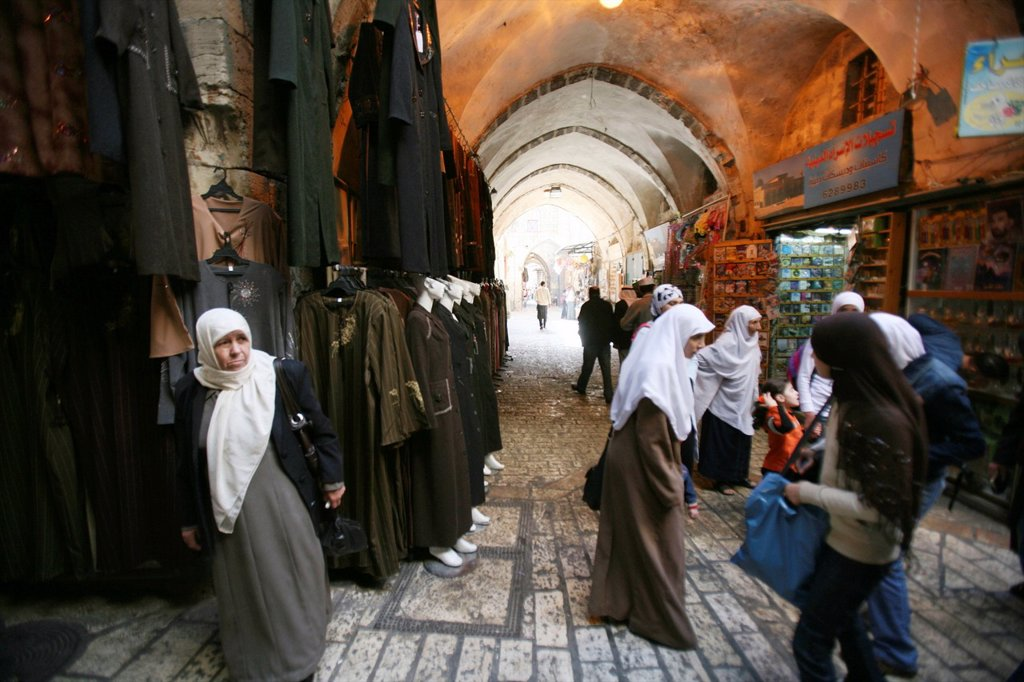 Stock Photo: 1566-976369 Muslim women shop at a market in the old city section of Jerusalem