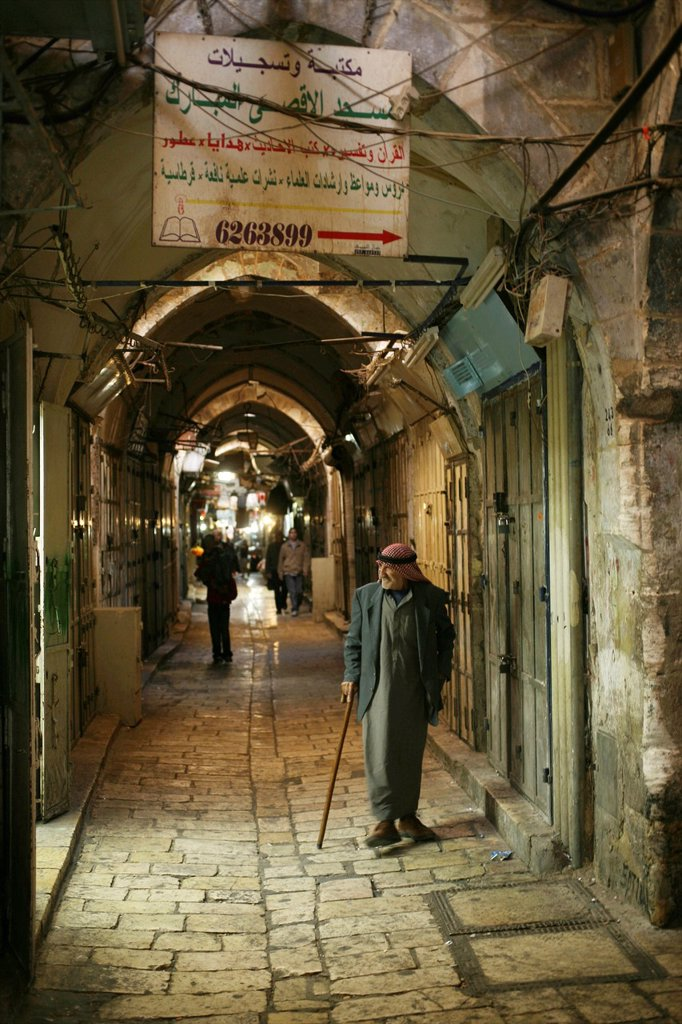 Stock Photo: 1566-976382 A Musliim man walks through a market in the old city section of Jerusalem