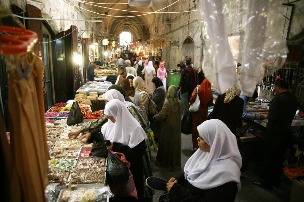Women buy sweets at a market in the old city section of Jerusalem : Stock Photo
