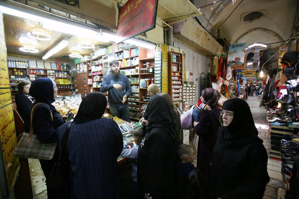 Stock Photo: 1566-976783 Muslim women at a crowded store at a market in the old city section of Jerusalem