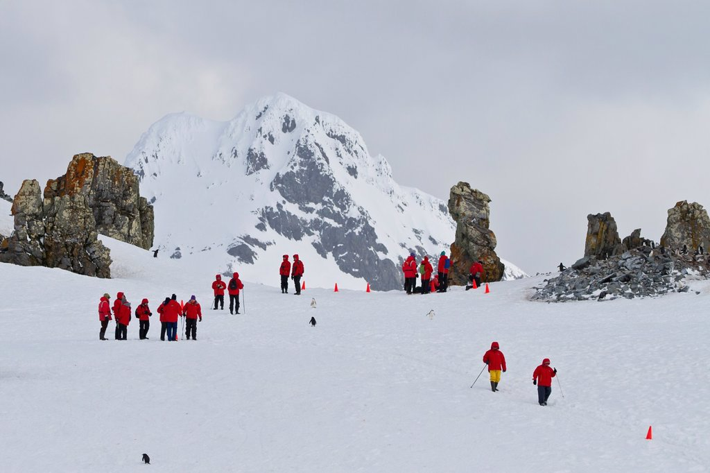 Stock Photo: 1566-977155 Guests from the Lindblad Expedition ship National Geographic Explorer enjoy hiking in Antarctica