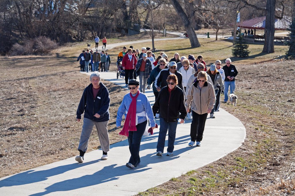 Stock Photo: 1566-977237 Centennial, Colorado - Participants in the ´Walk with a Doc´ exercise program walk along a trail in DeKoevend Park  The program was organized by a group of Denver-area doctors, it meets monthly for exercise and talk about how to live healthier