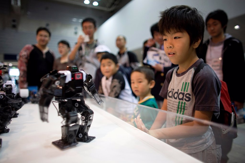 Stock Photo: 1566-977294 The first robot fair was held in Tokyo-Japan on 11 oct 2008 The main roboto builders showed their work at this venue This warrior or fighter robot can be bought by anybody under 18 If you have the money of course because the KHR - one of the coolest model