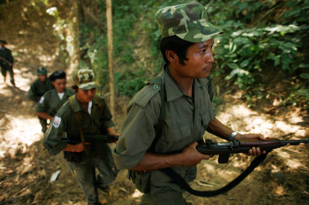 Stock Photo: 1566-977949 KNLA soldiers in the jungle near La Per Her In Myanmar Burma, thousands of people have settled near the border as a result of oppression in their homeland Around 200 Burmese displaced people have settled in La Per Her, a village on the Burmese side of the