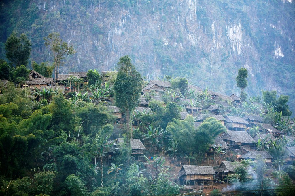 Stock Photo: 1566-977961 Family huts on a hillside in Mae Sot Around 130,000 Burmese refugees have settled in Thailand due to opression in their homeland of Myanmar Burma Approximately 30,000 refugees now live in Mae Sot western Thailand and receive humanitarian aid Another 200 B