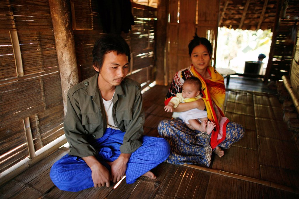 Stock Photo: 1566-978038 A Burmese family in their hut in La Per Her In Myanmar Burma, thousands of people have settled near the border as a result of oppression in their homeland Around 200 Burmese displaced people have settled in La Per Her, a village on the Burmese side of the