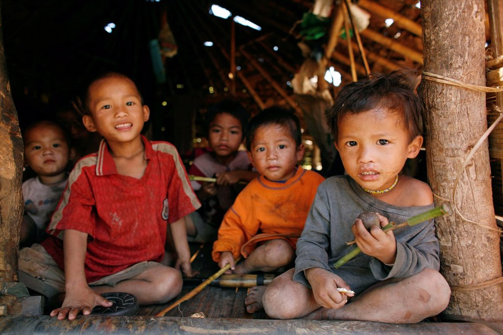 Stock Photo: 1566-978039 A group of Burmese boys in La Per Her In Myanmar Burma, thousands of people have settled near the border as a result of oppression in their homeland Around 200 Burmese displaced people have settled in La Per Her, a village on the Burmese side of the borde