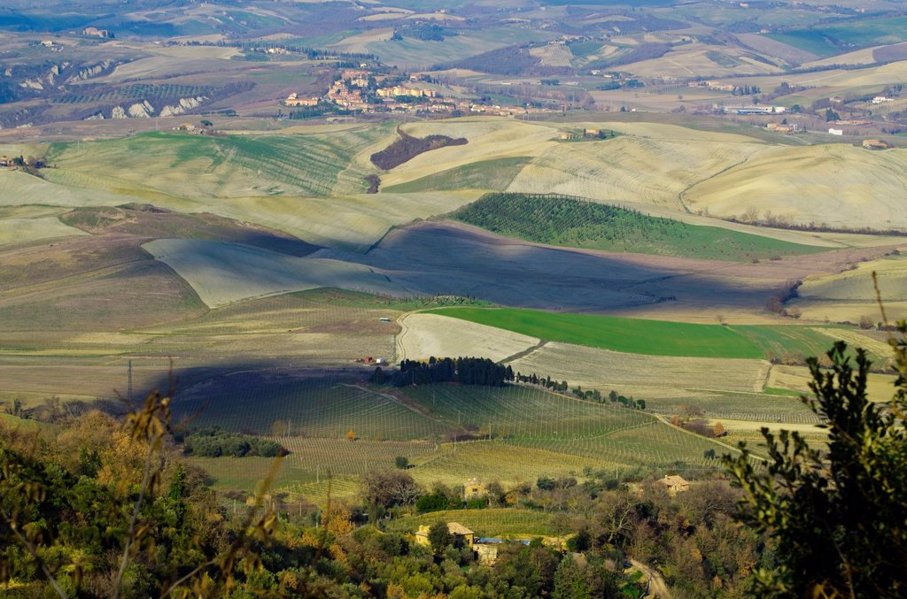 Stock Photo: 1566-978103 Panorama view over the field with shadows from the clouds in tuscany italy