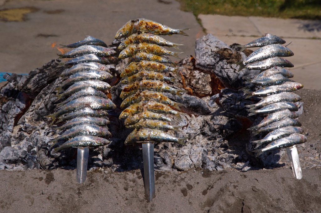 Stock Photo: 1566-978134 Sardines being grilled in a typical local beach grill Fuengirola city Costa del Sol coast the Malaga region Andalusia Spain Europe