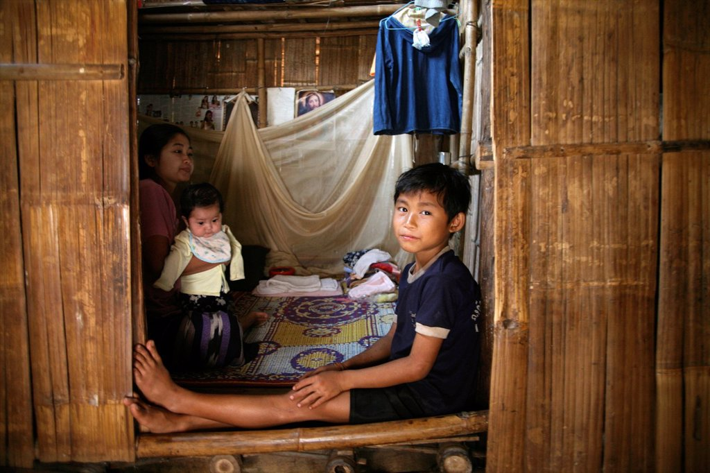 Stock Photo: 1566-978149 A refugee family living in Mae Sot Around 130,000 Burmese refugees have settled in Thailand due to opression in their homeland of Myanmar Burma Approximately 30,000 refugees now live in Mae Sot western Thailand and receive humanitarian aid Another 200 Bur