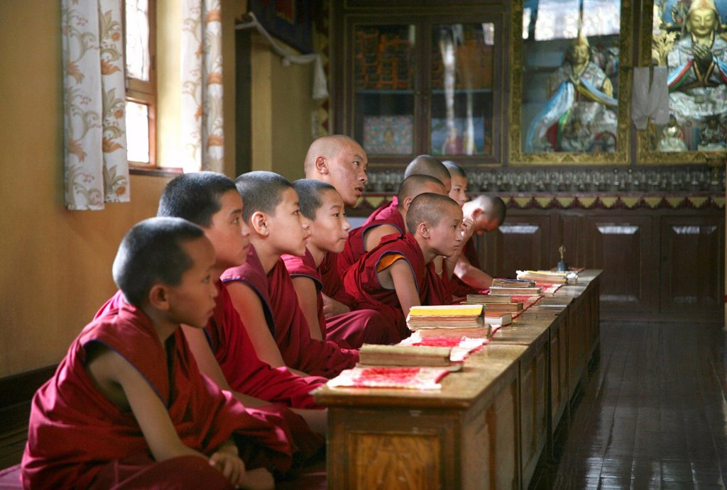 Tibetan monks in Kathmandu, Nepal The majority of monks in Nepal are refugees from Tibet and live in monasteries in Nepal Young monks go also to school every day, within the monastry : Stock Photo