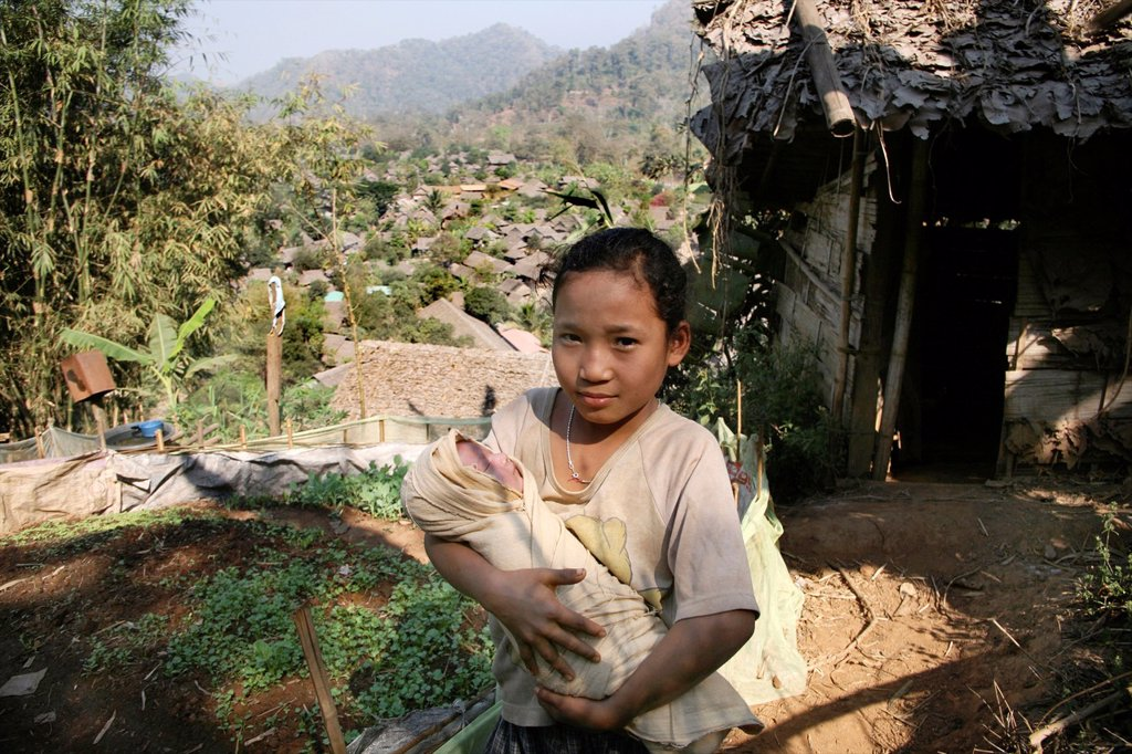 Stock Photo: 1566-978626 Around 130,000 Burmese refugees have settled in Thailand due to opression in their homeland of Myanmar Burma Approximately 30,000 refugees now live in Mae Sot western Thailand and receive humanitarian aid Another 200 Burmese refugees have settled in La Pe