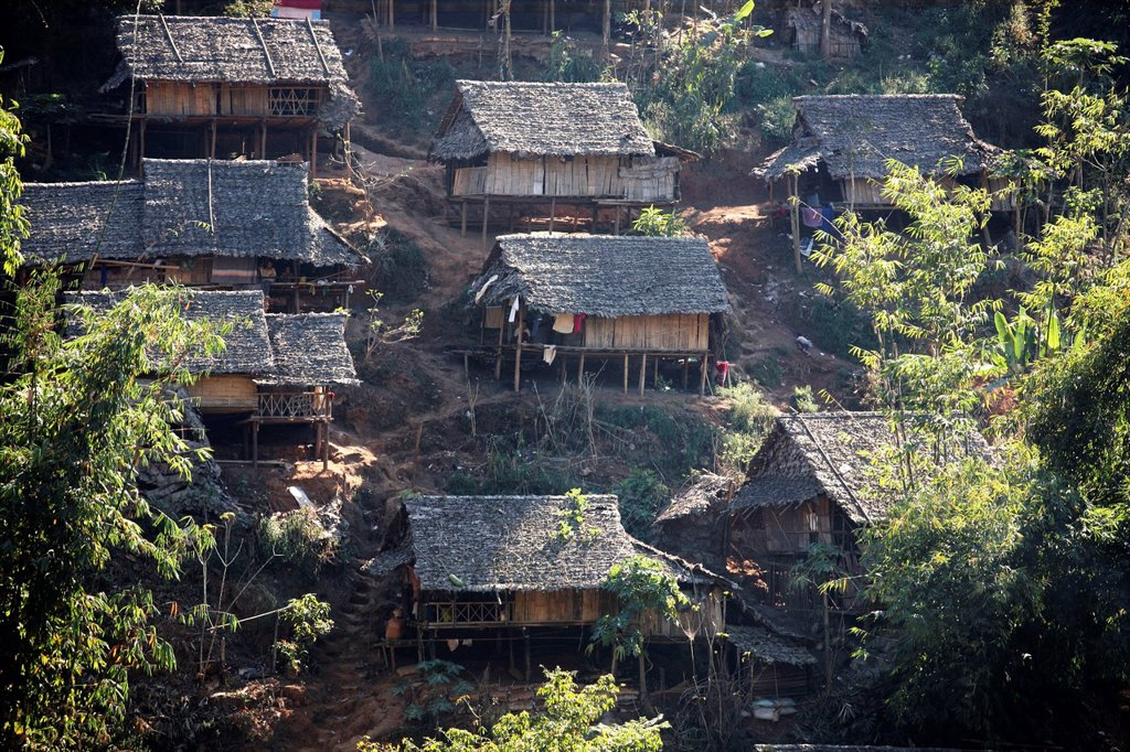 Stock Photo: 1566-978629 Closeup of refugee huts in a camp in Mae Sot Around 130,000 Burmese refugees have settled in Thailand due to opression in their homeland of Myanmar Burma Approximately 30,000 refugees now live in Mae Sot western Thailand and receive humanitarian aid Anoth