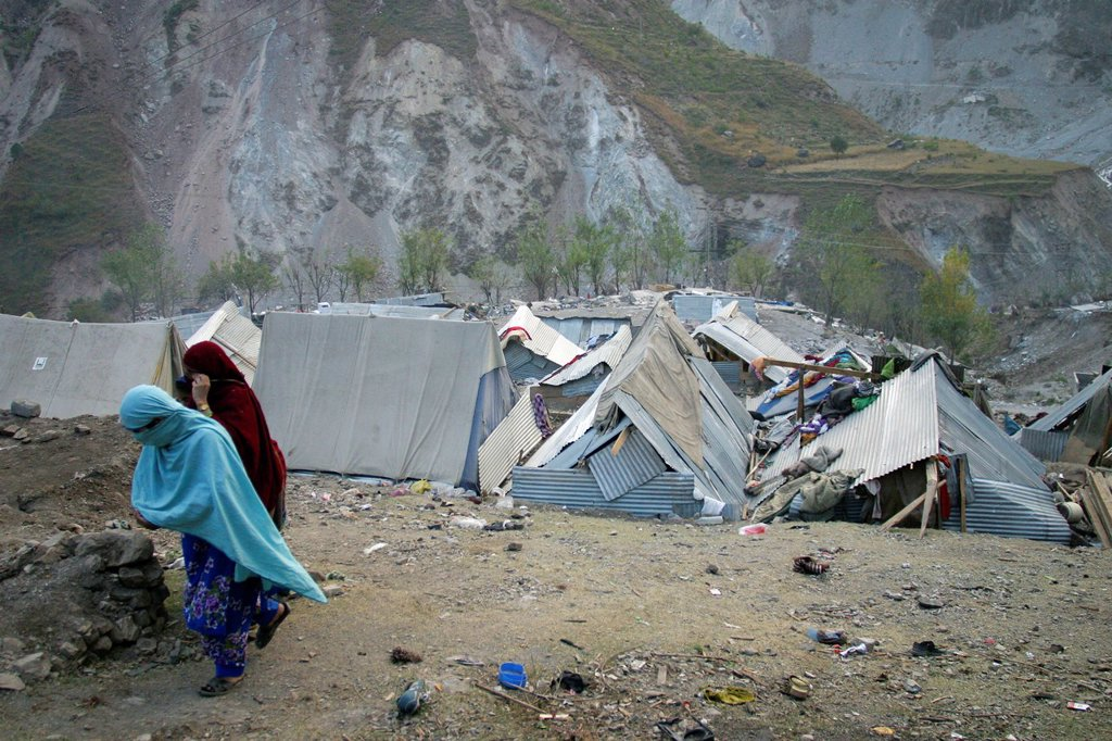 Stock Photo: 1566-978633 Many people did not received any aid and built some simple structures to stay dry from rain and snow The living conditions are very tough for people Muzafarabad, Kashmir, Pakistan On 8 october 2005, a severe earthquake hit Northern Pakistan Pakistan co