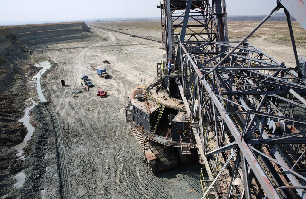 Stock Photo: 1566-978935 Maritsa Iztok is the largest coalmine in Bulgaria The coals are located 60 meter underground and the layer of coal is around 20 meter The coals are used for generating electricity by burning them The coalmine provides 85 of the country´s energy The US is